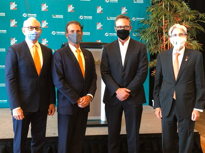 Dr. Stephen Nimer (left), Stuart Miller, Tom Garfinkel and Julio Frenk at the announcement of the Dolphins' $75 million commitment to cancer research.