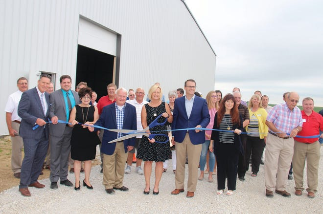 Local and state representatives help cut the ribbon during the spec building unveiling in July of 2018 at Perry Industrial Park. Perry Economic Development has announced the close of sale on the speculative warehouse shell to T.C. & B. Corporate Wearables, Inc.