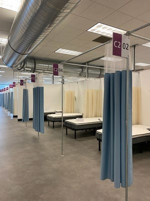 """The field hospital in Cranston, in a former Citizens Bank facility. Dubbed """"Fort Citizens,"""" it's the only oneof the three the state had originally identified that's still equipped to open up again in relatively short order."""