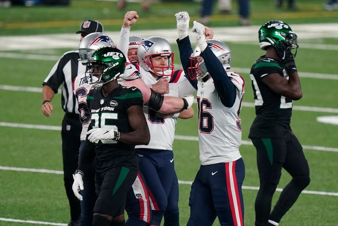 New England Patriots kicker Nick Folk reacts after kicking the winning field goal during the second half of an NFL football game against the New York Jets, Monday, Nov. 9, 2020, in East Rutherford, N.J. The Patriots defeated the Jets 30-27.
