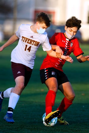 Owen Klusak (14) of Tiverton attempts to fend off a Providence Country Day player during Tuesday's match.