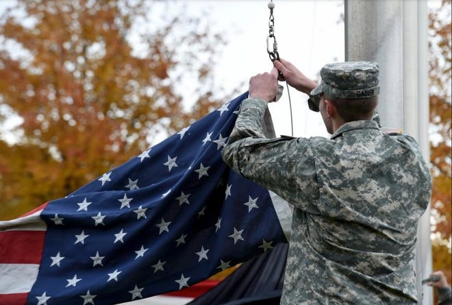 A Kent State University ROTC cadet raises the American Flag during a recent Veterans Day ceremony on campus.