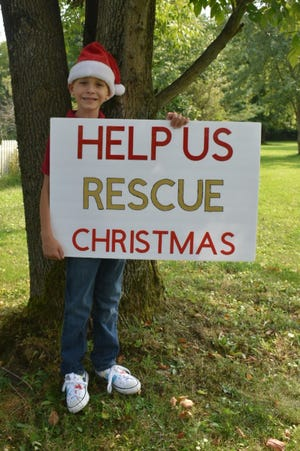 Logan Armstrong, 6, of Ravenna is asking Portage County residents to rescue Christmas by buying toys for needy children which will be distributed through the Salvation Army.