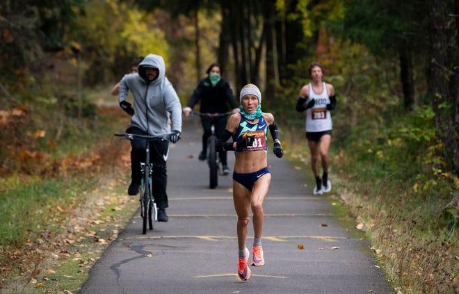 Jordan Hasay nears the finish line during a half-marathon race at Dorena Lake on Monday.