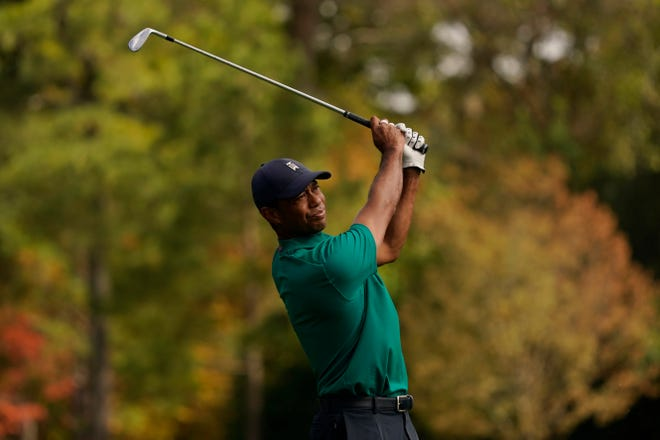 Tiger Woods watches his tee shot on the 12th hole during a practice round for the Masters on Monday in Augusta, Ga.