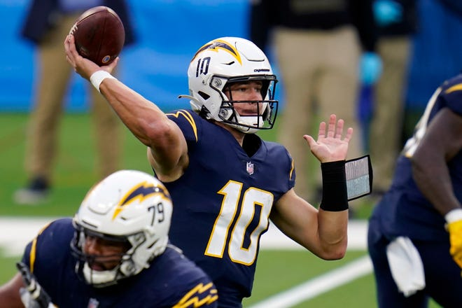 Los Angeles Chargers quarterback Justin Herbert threw for 326 yards and two touchdowns in Sunday's 31-26 loss to the Las Vegas Raiders.