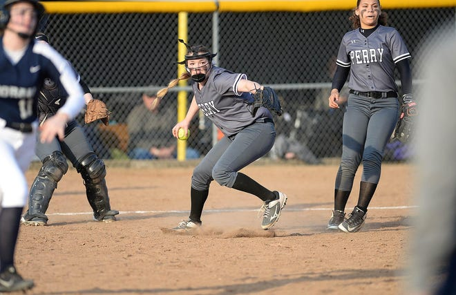 Perry pitcher Missy Holzopfel throws out Hoban's Hannah McGraw on a bunt attempt during the Panthers' 6-2 win, March 28, 2019. (CantonRep.com / Ray Stewart)