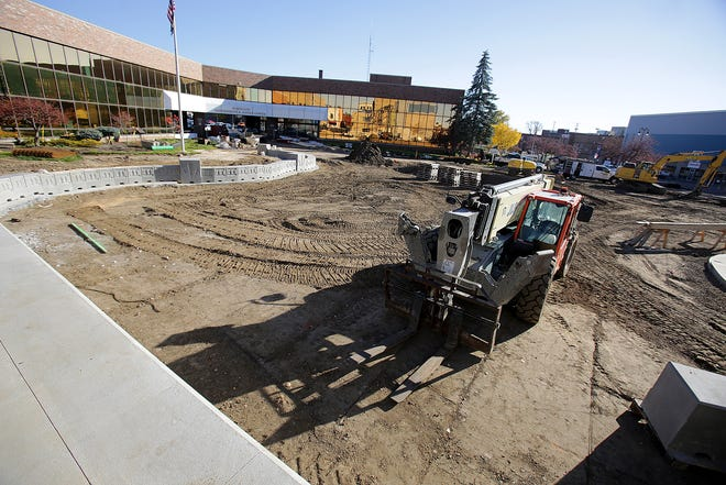 The concert stage at Duncan Plaza is taking shape in downtown Massillon. Concrete seating blocks, the stairway and retaining walls are being installed this week. The plaza project started in September and is expected to continue into the spring.