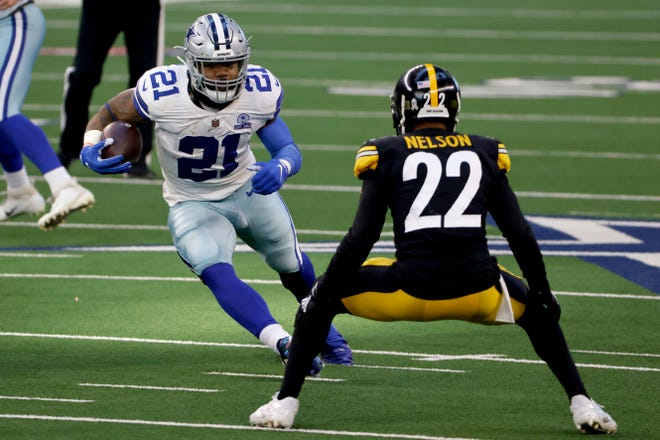 Dallas Cowboys running back Ezekiel Elliott (21) carries the ball as Pittsburgh Steelers' Steven Nelson (22) attempts to make a a stop in the first half in Arlington on Sunday.