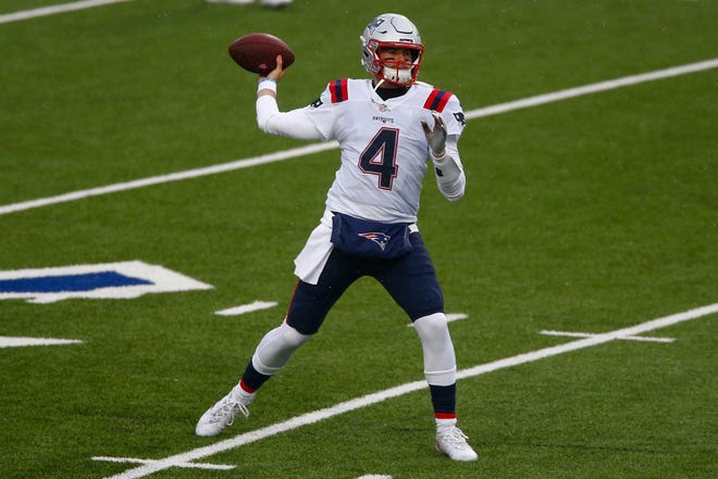 New England Patriots quarterback Jarrett Stidham (4) warms up before a game against the Buffalo Bills on Nov. 1, in Orchard Park, N.Y.