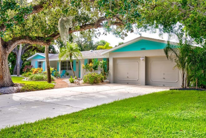 The neat and attractive concrete block Mid-century modern ranch house at 5450 Shadow Lawn Drive in the waterside neighborhood of Siesta Isles on Siesta Key was built in 1961 and sensitively renovated. The 1,600-square-foot, three-bedroom, two bath home is on the market for for $925,000. (Kev Lomas / Showcase Media)