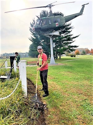 Dylan Powell (center) and Nate Squier work on the edges of the Kent County Veterans Memorial Park on South Little Creek Road, Dover, in preparation for the Veterans Day ceremony which has been moved to Saturday, Nov. 14.