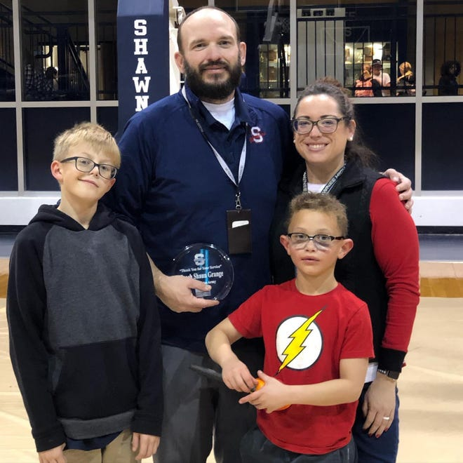 Sequoyah Elementary School counselor and veteran Shaun Grange with his wife Hillary and sons Eli and Peyton.