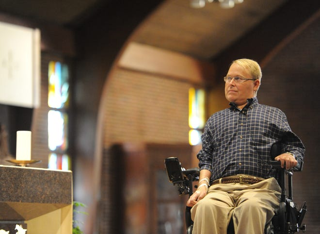 Travis Roy, shown here speaking at St. Pius X School in South Yarmouth, came to Tabor Academy in 1993 as a junior hockey player. He continued a lifetime connection to the school until his death last month. [Merrily Cassidy/Cape Cod Times]