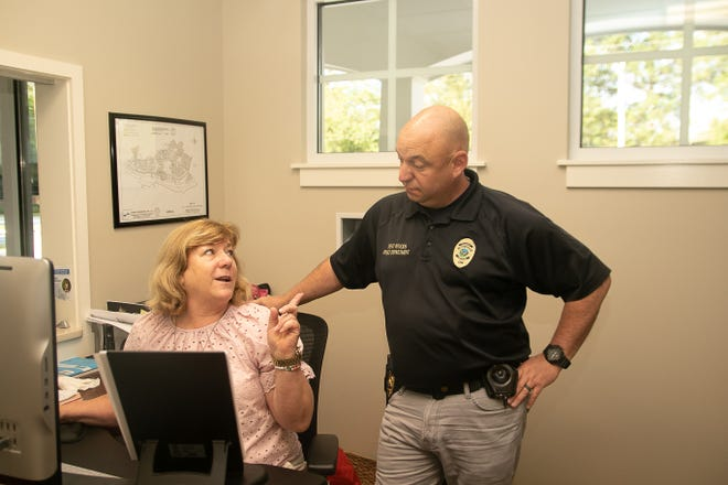Trent Woods town clerk Holly Willis discusses Christmas parade plans with Police Chief Tony Lee. Lee has returned to the position he had vacated a year ago to work with the Craven County Sheriff's Office. [Bill Hand / Sun Journal Staff]
