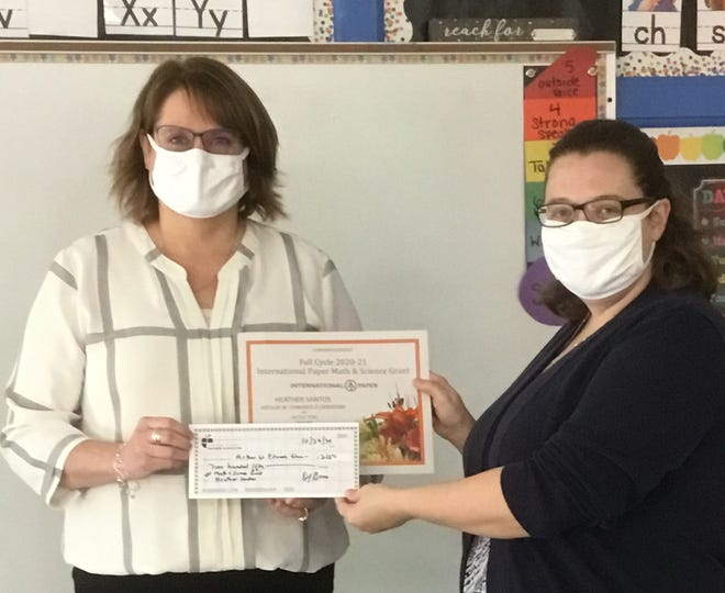 "Heather Santos, kindergarten teacher at Arthur W. Edwards Elementary, was awarded a Fall Cycle International Paper Math & Science Grant of $250. The grant is titled, ""Tactile Tens Frames."" Ms. Santos explains, ""The goal is to equip every kindergarten student with their own tens frame and counters to use throughout the year. Due to restrictions from Coronavirus, students are not able to share manipulatives this year. Ten frames are used in kindergarten to help with developing number sense, a student's ability to understand, relate, and connect with numbers.  This develops throughout the year as children explore numbers and have hands-on experiences with them. These tens frames will help give students the tactile and visual experiences they need when working with numbers.""  Shown is Ms. Santos accepting her check from Melisa Thompson, principal, at Arthur W. Edward Elementary. [CONTRIBUTED PHOTO]"