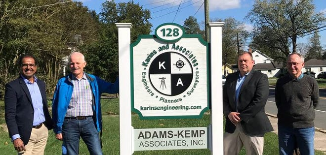 Karins and Associates, an engineering, surveying and planning firm, announced the acquisition of Adams-Kemp Associates, a land planning and surveying firm in Georgetown. From left, Dev Sitaram, Chuck Adams, R.B. Kemp and John Johnson.