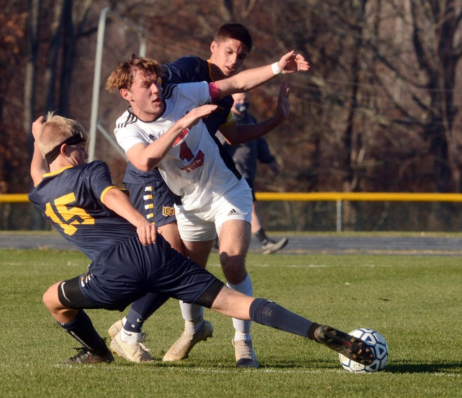 Woodstock Academy's Noah Page and Windham Tech's Dustin Garrison battle for the ball Tuesday during their game in Woodstock.