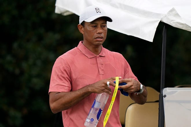 Tiger Woods leaves the driving range during a practice round for the Masters golf tournament on Tuesday.