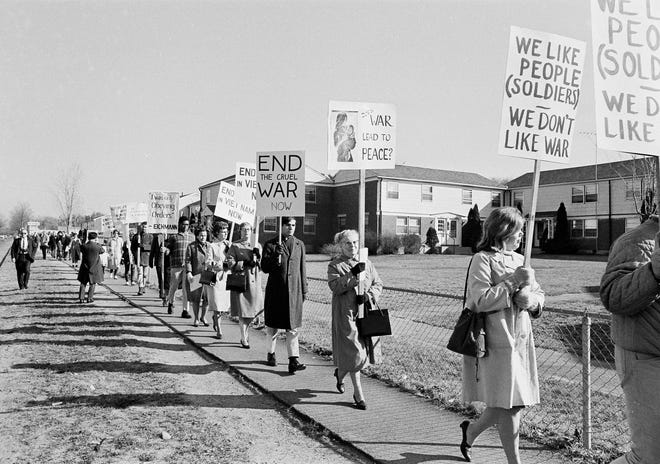 Pickets from various peace organizations protest the nation's role in the Vietnam war outside Fort Devens, Mass., military reservation, Nov. 11, 1965.