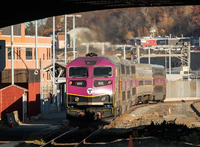 An MBTA commuter rail train leaves Union Station in Worcester.