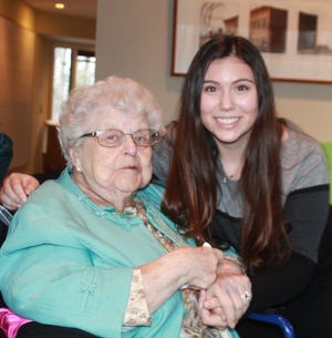 My Aunt Shirley posing with one of her nieces during our family Chanukah party. She treasured these times with family.