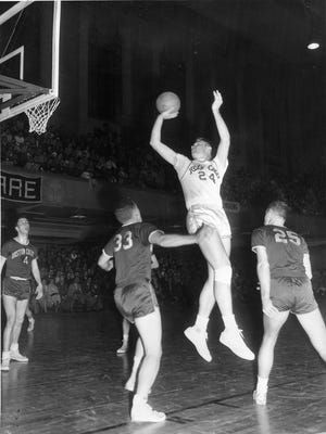 Tommy Heinsohn starred at Holy Cross when the team played at Worcester Memorial Auditorium. His Number 24 was later retired by Holy Cross. This photo is from March 1956.