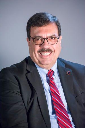 John Halkias.