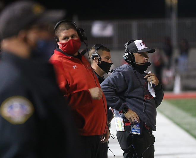 New Philadelphia head football coach Matt Dennison ponders his next move as the Quakers took on Youngstown Chaney in a playoff game this past season.
