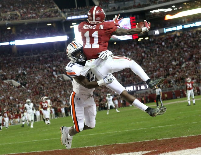 Auburn defensive back Roger McCreary (17) hits Alabama wide receiver Henry Ruggs III (11) before the ball arrives as Ruggs hauls in a touchdown pass in Bryant-Denny Stadium during Alabama's 52-21 victory over Auburn in the Iron Bowl Saturday, Nov. 24, 2018. [Staff Photo/Gary Cosby Jr.]