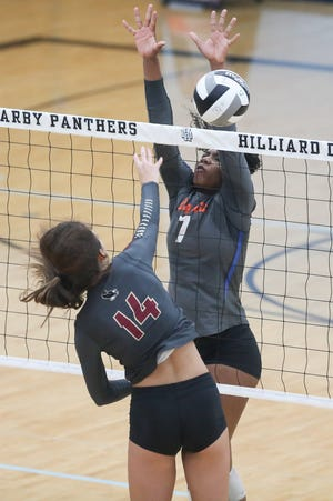 Orange senior London Davis (7) blocks Watterson's Gina Grden during the Pioneers' 17-25, 26-24, 25-23, 25-21 loss in the Division I regional final Nov. 7 at Hilliard Darby. Davis, a Kansas recruit, was first-team all-district and the OCC-Central Division Player of the Year.