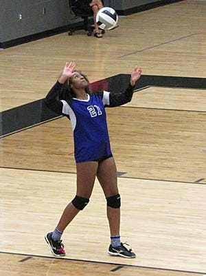 Africentric's Maliyah Johnson serves during a semifinal of the City League girls volleyball tournament. The Nubians won the championship with a 25-18, 18-25, 25-27, 25-20, 15-11 victory at Whetstone on Nov. 11.