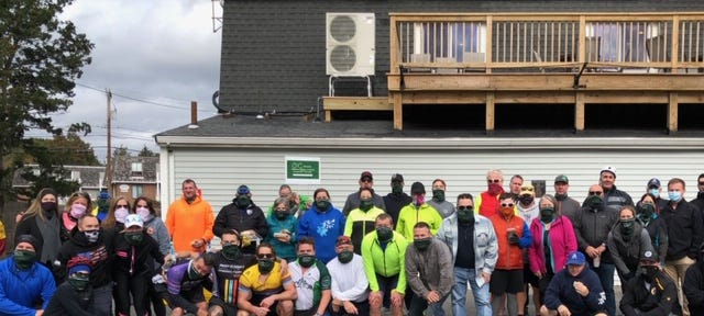 Marshfield Elks Lodge 2494 recently donated their lodge facilities in support of the South Shore Tour. Pictured are biking participants in the parking lot of Elks Lodge. [Courtesy Photo]