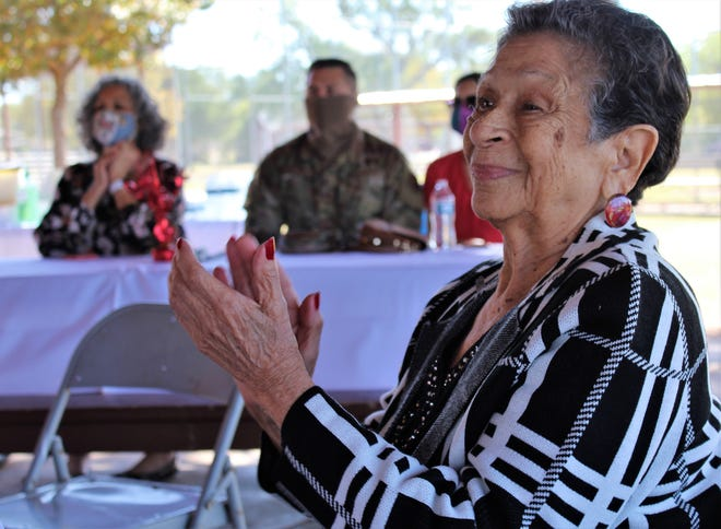 Antonia Ramirez Cisneros claps after mariachi singer Jose Chavez performed at a gathering in her honor Saturday at Sears Park. Her family thanked Cisneros, 87, for her community and family leadership through the years.