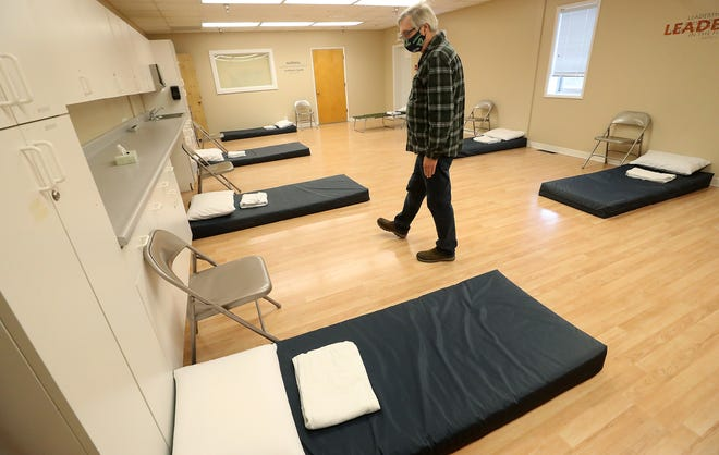 Roland Arper, manager of the United Methodist Church Severe Weather Shelter, walks through one of the rooms that are set up at the church in Port Orchard on Monday, Nov. 9, 2020.