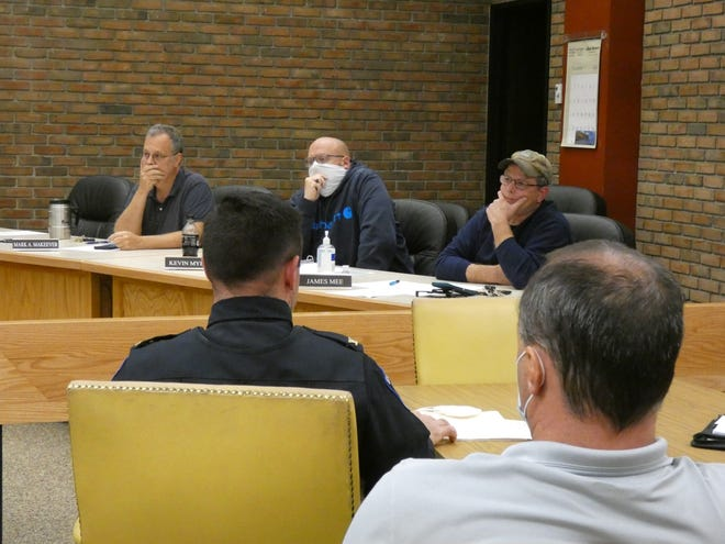 Three members of the Bucyrus City Council  Health and Safety Committee, Mark Makeever, Kevin Myers and James Mee, from left, listen to discussion about the future of ambulance service in the community Monday evening. Watching in the foreground are police Chief Neil Assenheimer and acting fire Chief Chad Schwemley.