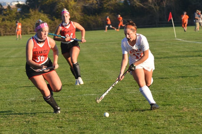 Ocean City senior Katie Bowman channels a Middle Township player down the alley.