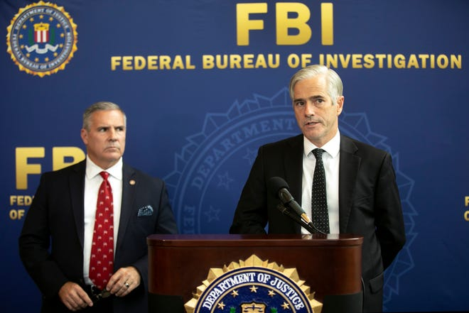 Chris Hoffman, special agent in charge of Cincinnati's FBI division, left, and David M. DeVillers, United States Attorney for the Southern District of Ohio, discuss indictment charges against Jeffrey Pastor, city council member and business partner, Tyran Marshall, Tuesday, Nov. 10, 2020, at FBI headquarters in Kenwood. They are being charged with conspiracy involving wire fraud, bribery, money laundering and attempted extortion by a government official.