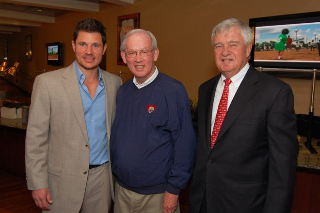 Attending the 2011 Kid Glove annual luncheon are, from left, Kid Glove Games Honorary Chairman Nick Lachey, Kid Glove Games executive secretary Paul Kramer, and Reds president and chief executive officer Bob Castellini.
