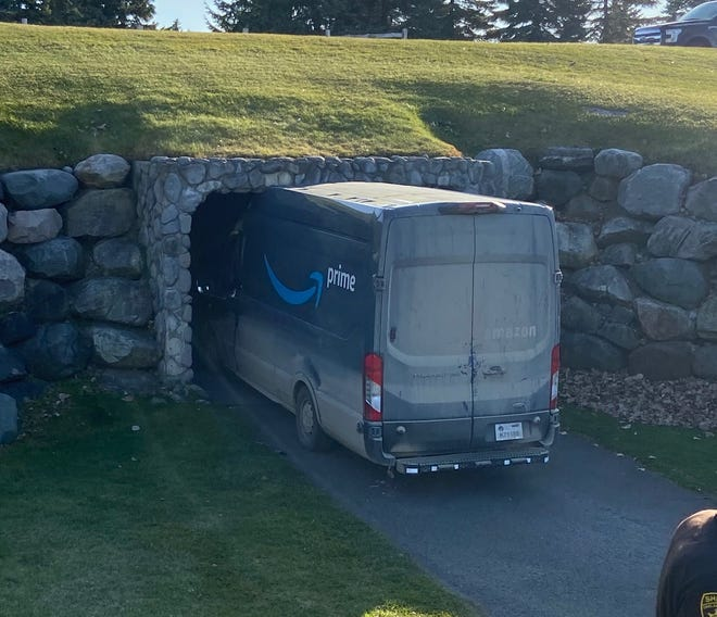 A photo taken by Bill Offer, a club supervisor,  shows an Amazon truck stuck in a golf cart tunnel about 2:30 p.m. Nov. 7, 2020, at the Boulder Pointe Golf Club in Oxford, Mich.