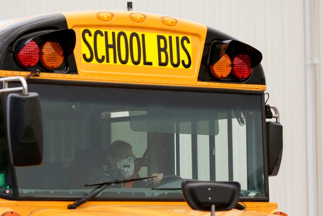 A bus leaves the Tippecanoe School Corporation Transportation and Service Center, Tuesday, Nov. 10, 2020 in Lafayette.