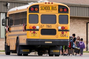 Student load onto buses at Wyandotte Elementary School, Tuesday, Nov. 10, 2020 in Lafayette.