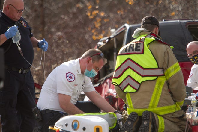 Livingston County EMS paramedics, assisted by Fowlerville Area Fire Department personnel, tend to a patient at a crash on the south side of Grand River near the Fowlerville Fair Grounds on Tuesday, Nov. 10, 2020.