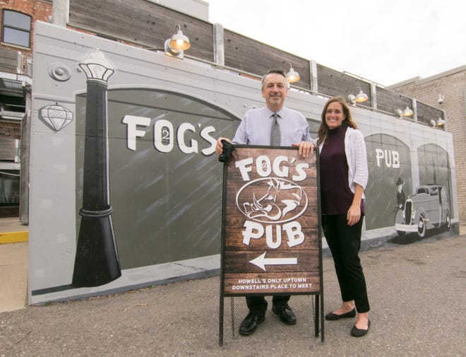 2FOG's Pub General Manager Dan Carter and Manager Brooke Sredzinski stand in back of the restaurant, which reopened under new owners last month, Tuesday, Nov. 10, 2020.