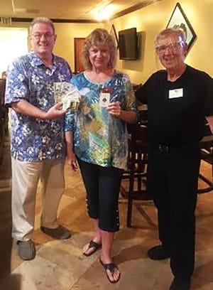 President Lucky Lang, 50/50 winner Cindy Crane and Treasurer John Coff.