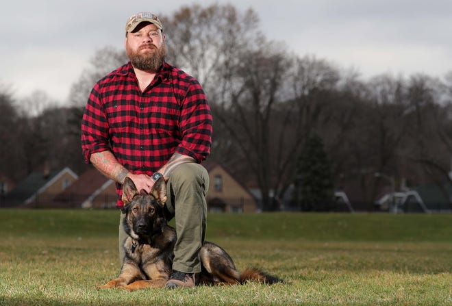 Marine veteran John Matter with his dog, Zuul, a German Shepherd trained and given to him through Sierra Delta, at Hart Park in Wauwatosa. Sierra Delta, a Wisconsin nonprofit, provides training for dogs for any veteran who wants one.