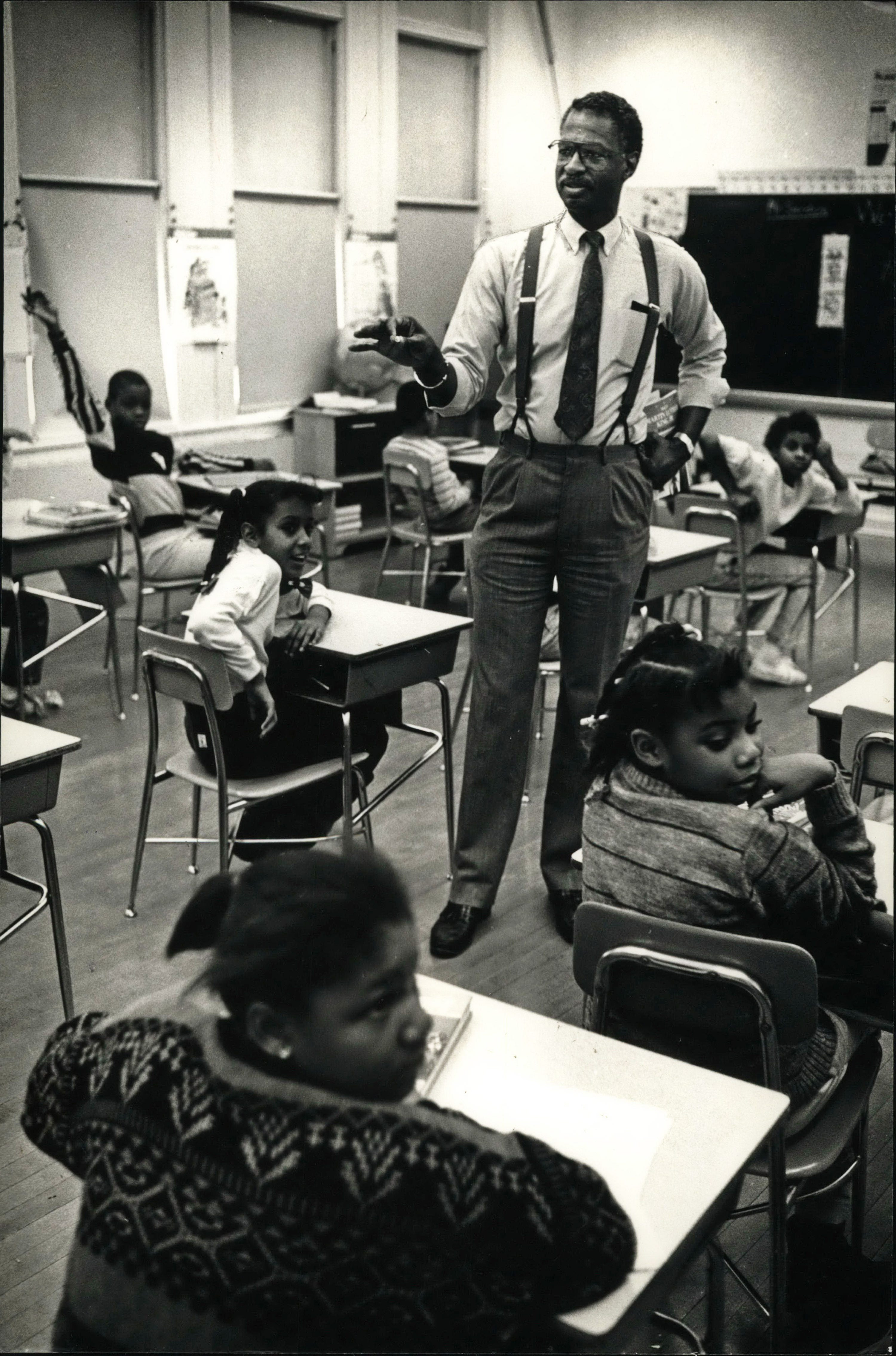 A pupil at Victor Berger School, 3275 N. 3rd St., raises his hand for a chance to answer a question asked by Howard L. Fuller, Milwaukee County director of health and human services, in this Journal Sentinel 1990 file photo.  Fuller visited the school as a participant in the Martin Luther King Jr. read-in event.