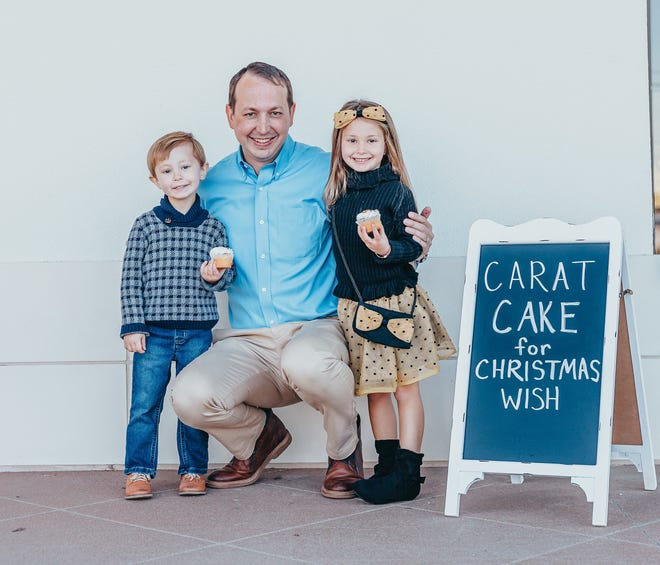Chris Carter from Carter's Jewel Chest, along with his friends Harlynn Bo and Benjamin Brown, at the 2020 Carat Cake fundraiser for Christmas Wish.