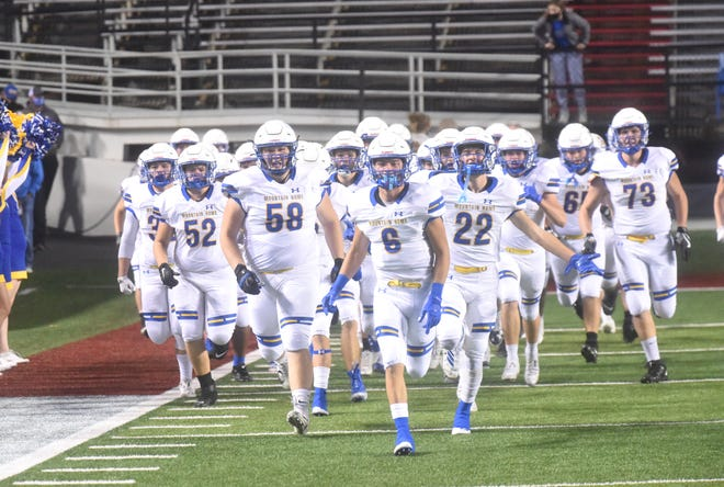 The Mountain Home Bombers take the field last week at War Memorial Stadium in Little Rock.