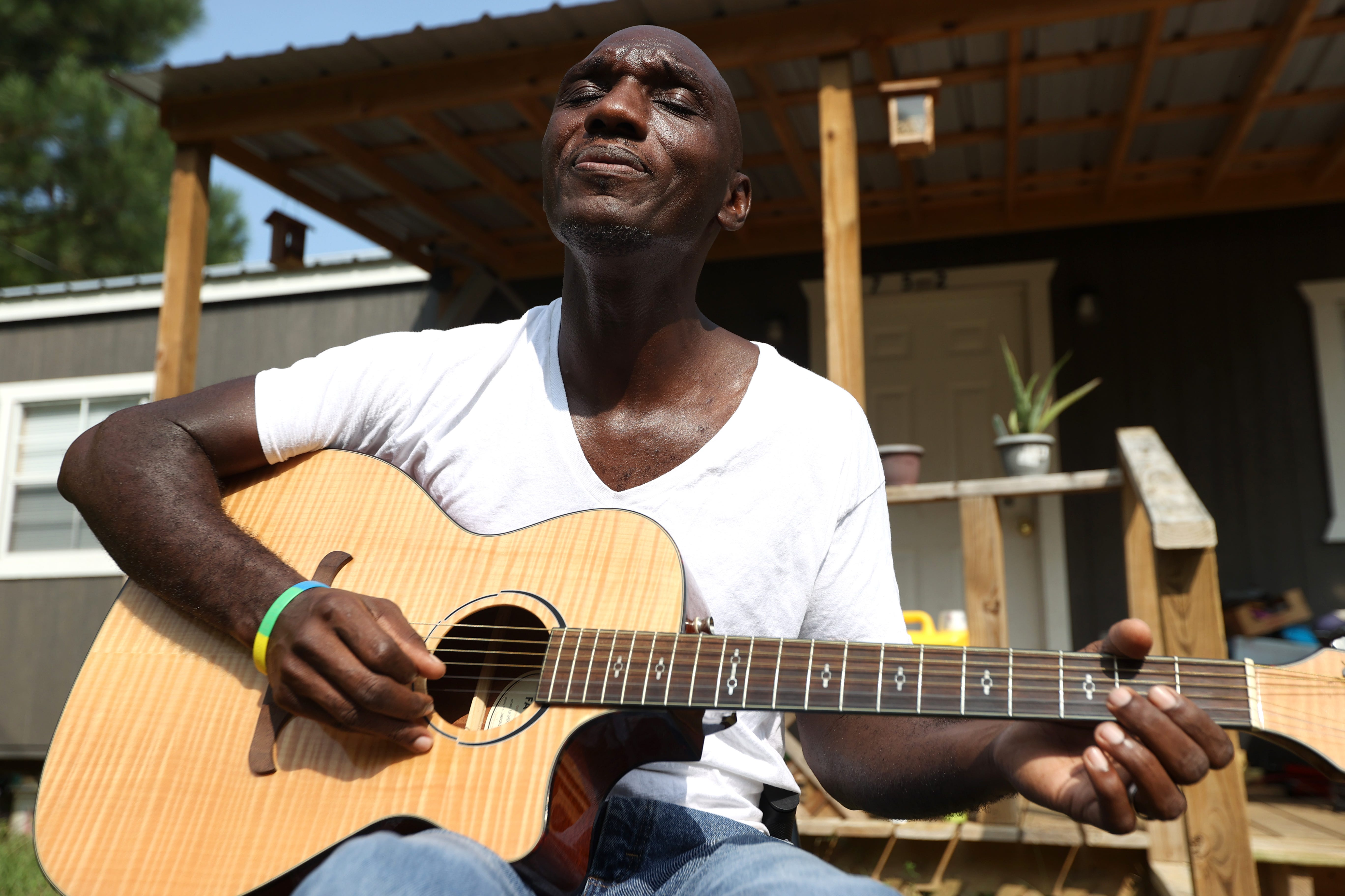 Cedric Burnside, a third-generation hill country blues artist, outside of his Ashland, Mississippi home on Tuesday, Sept. 15, 2020. Burnside, who has been playing professionally since he was 13-years-old, followed in the family footsteps of his drummer father Calvin Jackson and grandfather RL Burnside, whose music saw major success worldwide late in his career.